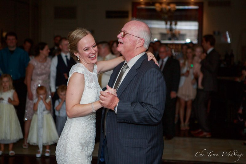 Candid bride laughing with her father on the dance floor