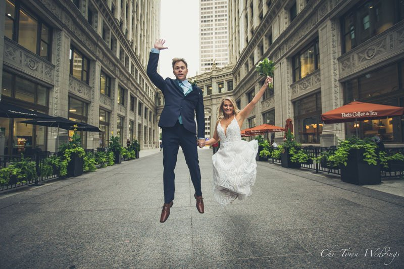 Bride and Groom jumping at the Wrigley Building, Chicago