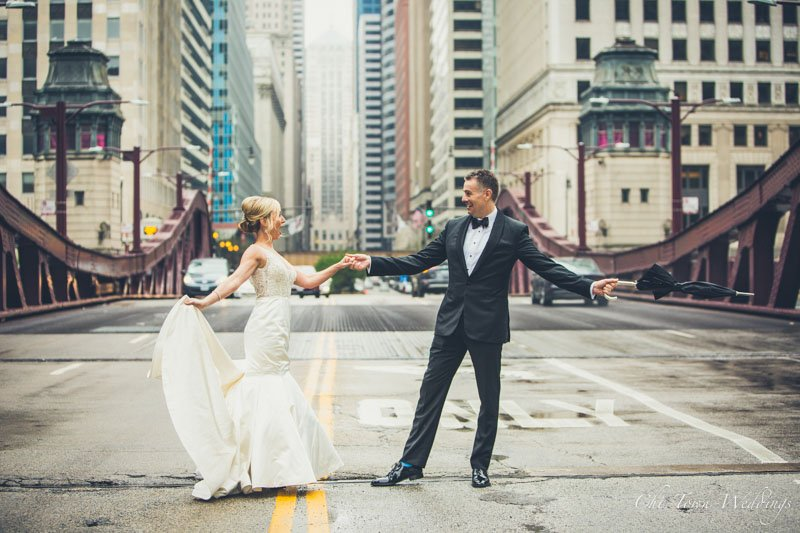 Bride and Groom dancing in the street at Lasalle Street Bridge Chicago