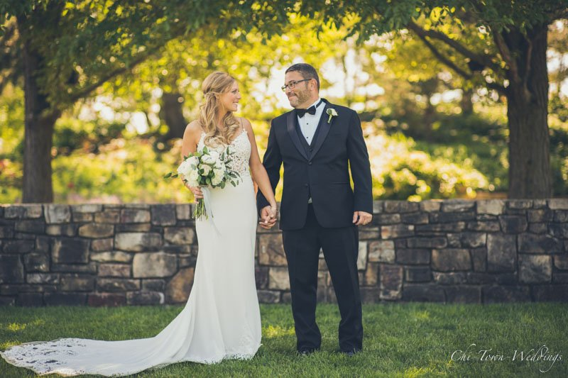 Bride and Groom posing during the fall