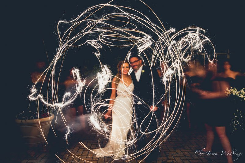 Bride and groom long exposure with light streaks all around them