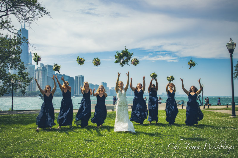 www.Chi-Town-Weddings.com  Bridesmaids catching flowers in the wind olive park Chicago